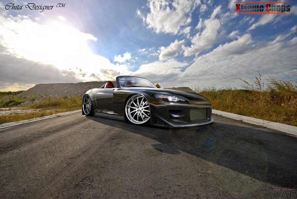 Wallpapers with ergonomic car Honda S2000 against the blue cloudy sky